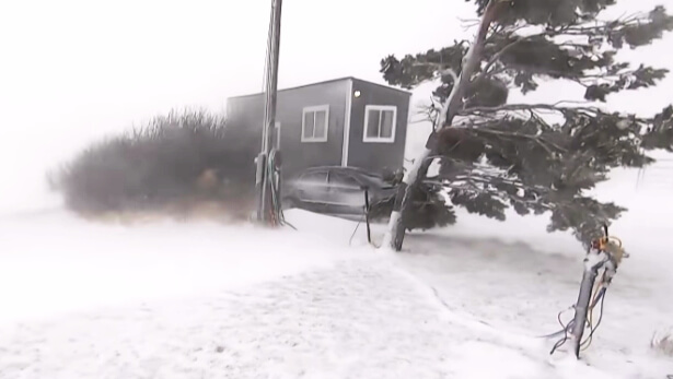 small house in snow storm