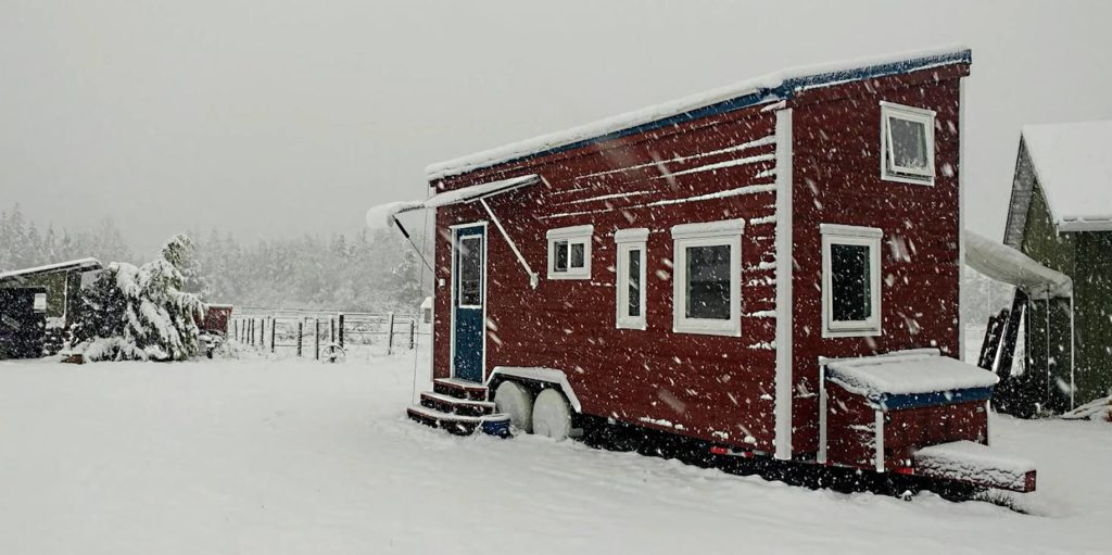 tiny house covered with snow