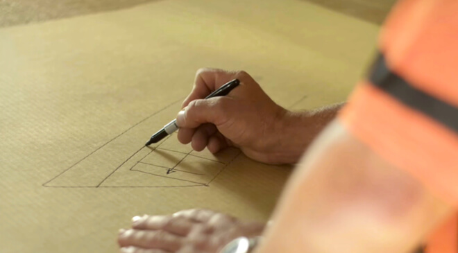 man drafting a house on paper