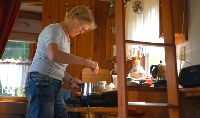 senior woman in her tiny house cooking