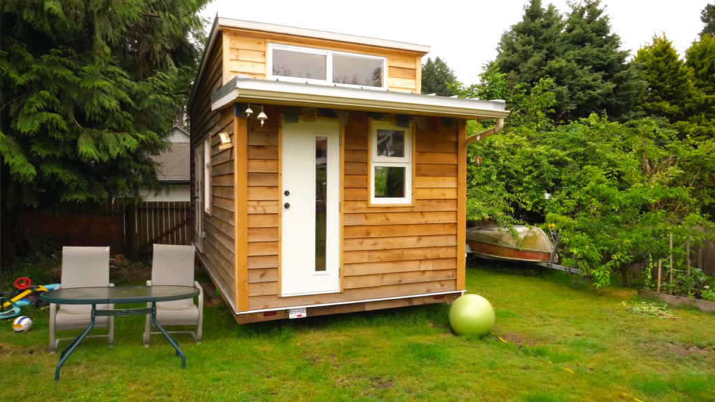 tiny house on wheels in the backyard